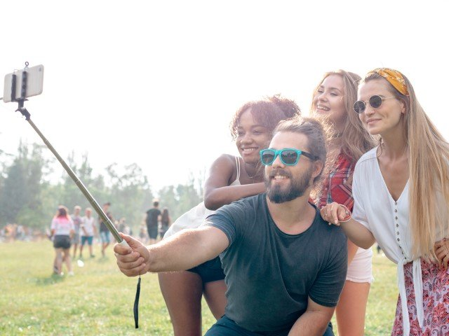 friends-at-music-festival-taking-live-video-to-soc-7KU6DPY
